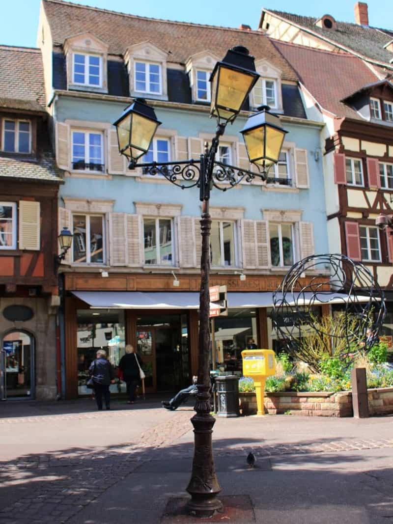 colmar france exterior decoration traditional half timbre building lamppost