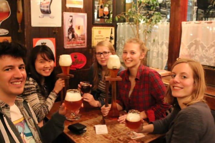 local pub with friends beers, ghent, belgium