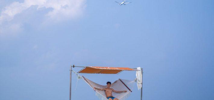 taj-exotica-maldives-lagoon-beach-boy