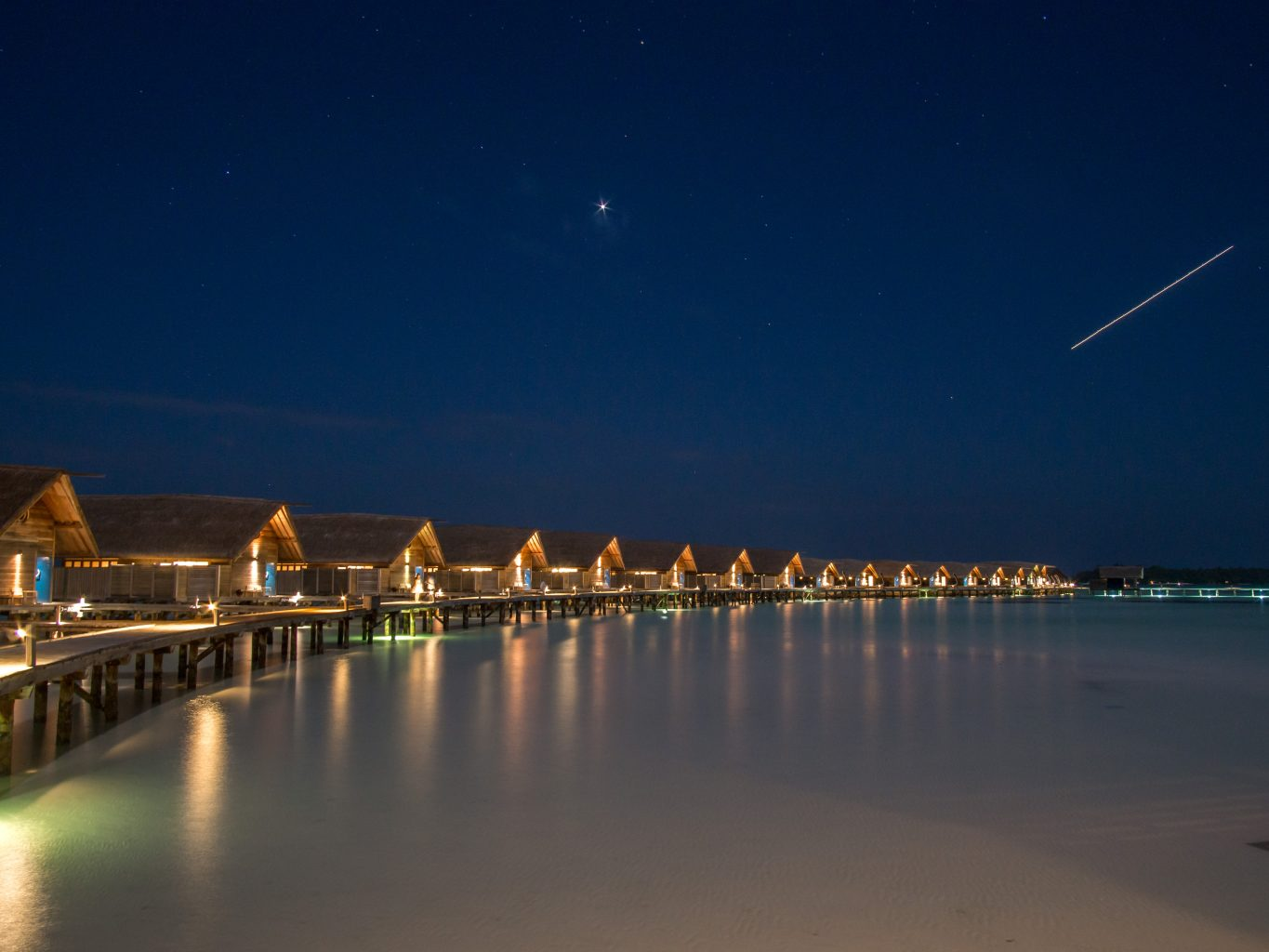 COMO-Cocoa-Island-boardwalk-night-villa maldives