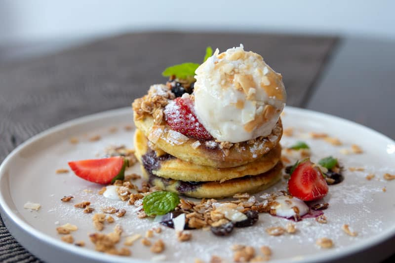 The Junction House Cafe Bali Seminyak Kuta Where to Eat in Bali Best Cafes Western Asian Vanilla Pancake Stack Strawberries Dessert