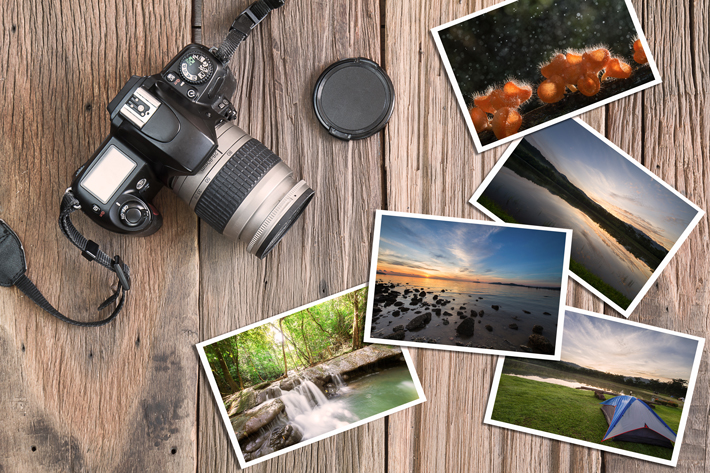 TRAVEL GIFTS Old-camera-and-photos-on-vintage-wooden-background