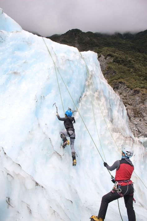 ice climbing girl, fox glacier, new zealand