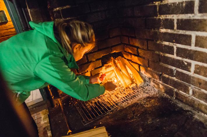 lighting fire, green window Nuuksio National Park