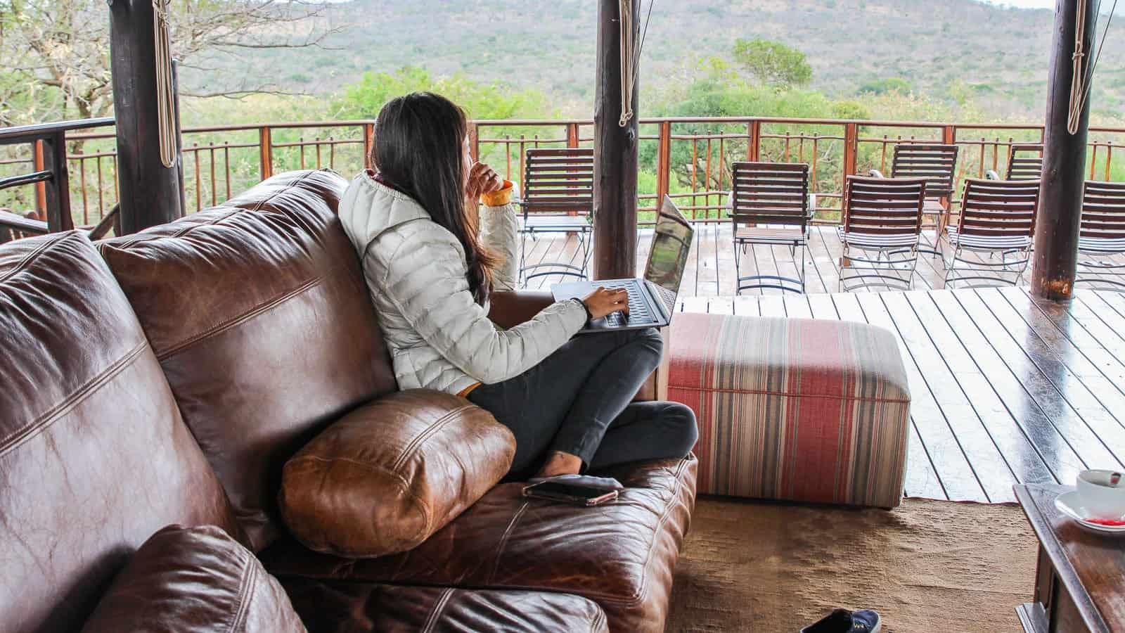 Thanda-girl laptop digital nomad travel blogger